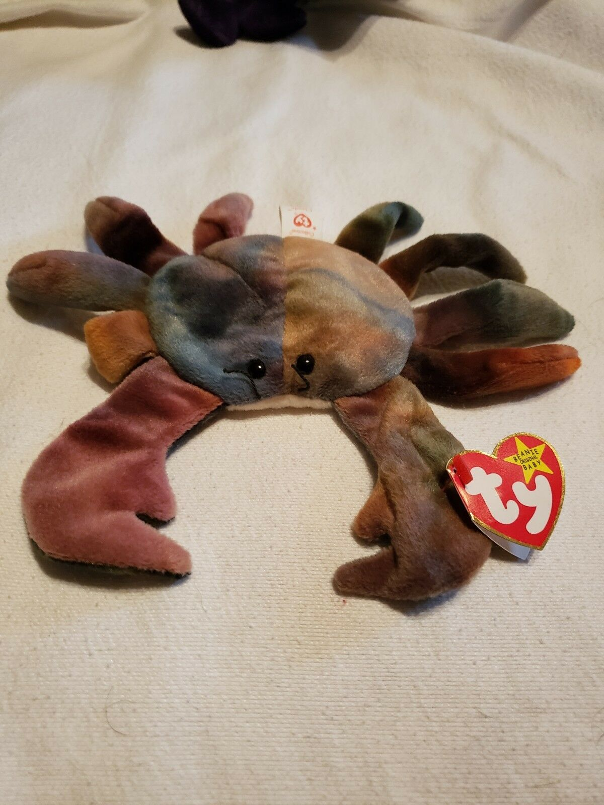 Ty Beanie Babies Claude the crab never played with and stored in container.