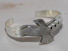 handmade bird bracelet in sterling with garnet and peridot