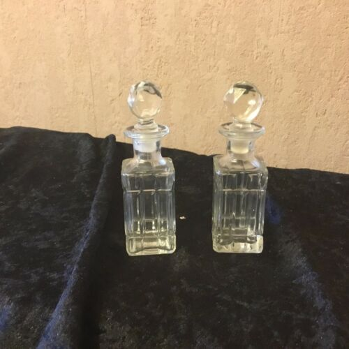 A Pair Of Mouldedpressed Glass Perfume Bottles.