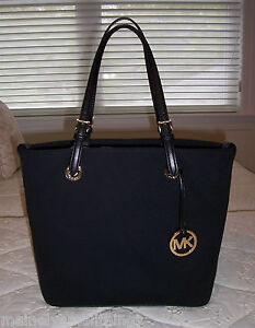 52369a0fab NWT Michael Kors Jet Set Grab Bag Convert Tote Bag Canvas   Leather ...