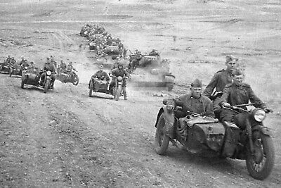 Soviet M-72 motorcycles and T-34-85 tanks on a march near Odessa ...