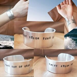 """Handcrafted """"every storm runs out of rain"""" aluminum cuff bracelet"""
