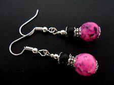A PAIR BLACK AND PINK MARBLED GLASS PEARL DANGLY EARRINGS.