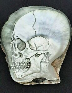 hand crafted mother of pearl Human Skull : iridescent : in the style of Halili a