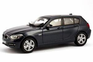 1-43-BMW-1er-F20-2011-5-portes-5door-125i-Sport-bleu-nuit-bleu-Dealer-Edition
