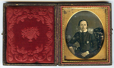 1/6 PLATE DAGUERREOTYPE PORTRAIT OF A YOUNG WOMAN WITH BROOCH DELICATELY TINTED
