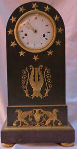 Pendule-Epoque-Directoire-en-Bronze-Double-Patine-a-l-Ouroboros