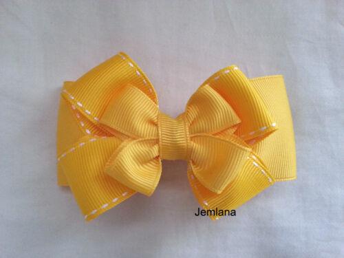 Jemlana/'s handmade school hair clips for girls.