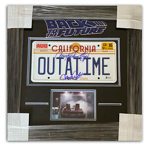 LLOYD-MICHAEL-J-FOX-BACK-TO-THE-FUTURE-SIGNED-OUTATIME-LICENSE-PLATE-FRAMED-BAS