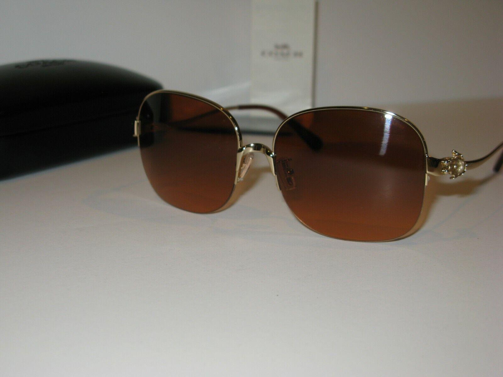Coach Women's Light Gold / Milk Amber Sunglasses with Case. HC7068 (L1609).
