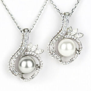 Starstruck Clear Swarovski Elements crystal with a Pearl fashion Pendant Necklac