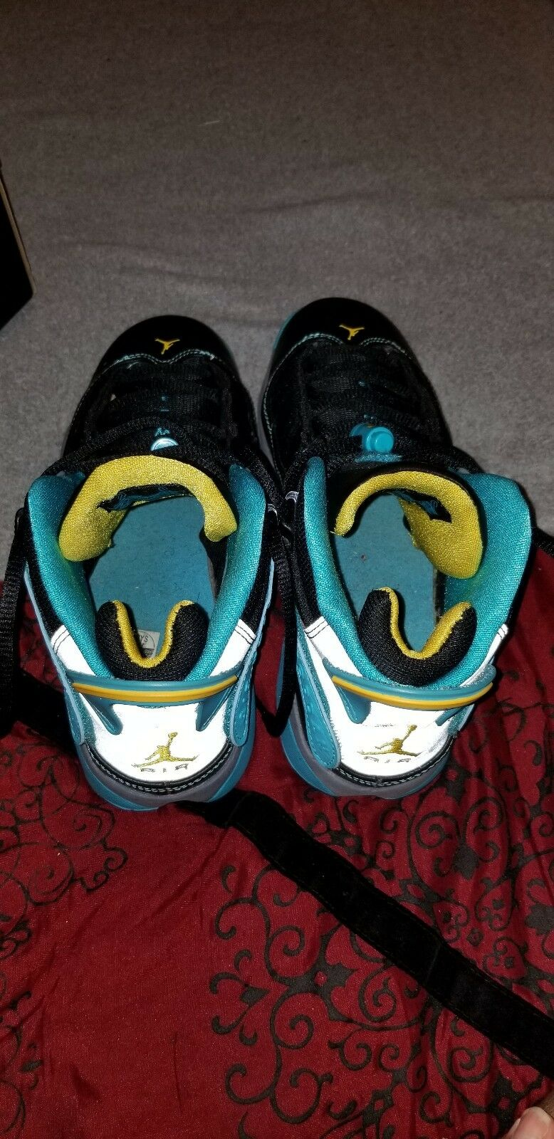 Nike air jordan 6 rings, yellow and turquoise accent with reflector back.