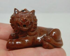 Carved-Mahogany-Obsidian-Lion-Figurine-81840