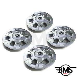 new bmw mini one cooper s 15 silver wheel trim hub cap set x4 r50 r56 ebay. Black Bedroom Furniture Sets. Home Design Ideas