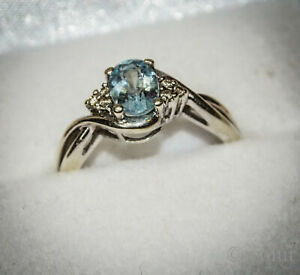 Attractive-9ct-White-Gold-Faceted-Aquamarine-and-Diamond-Dress-Engagement-Ring