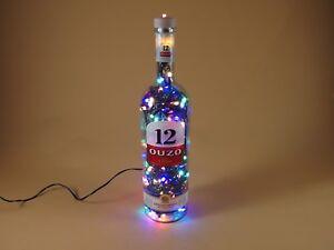 OUZO-12-Flaschen-Lampe-mit-120-LEDs-Warmweiss-UND-Multicolor-UMSCHALTBAR
