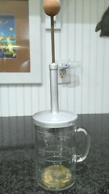VINTAGE FOOD CHOPPER A Pamco NutFood Chopper With Measuring Cup And Bright Red Handle.