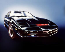 Knight Rider Kit Car Displayed With Red Lights On Glowing Background Poster
