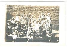 Foto Abb.Kinder im Kindergarten? Eisenkarusell,Junge beim Beten.Mädchen m. Puppe