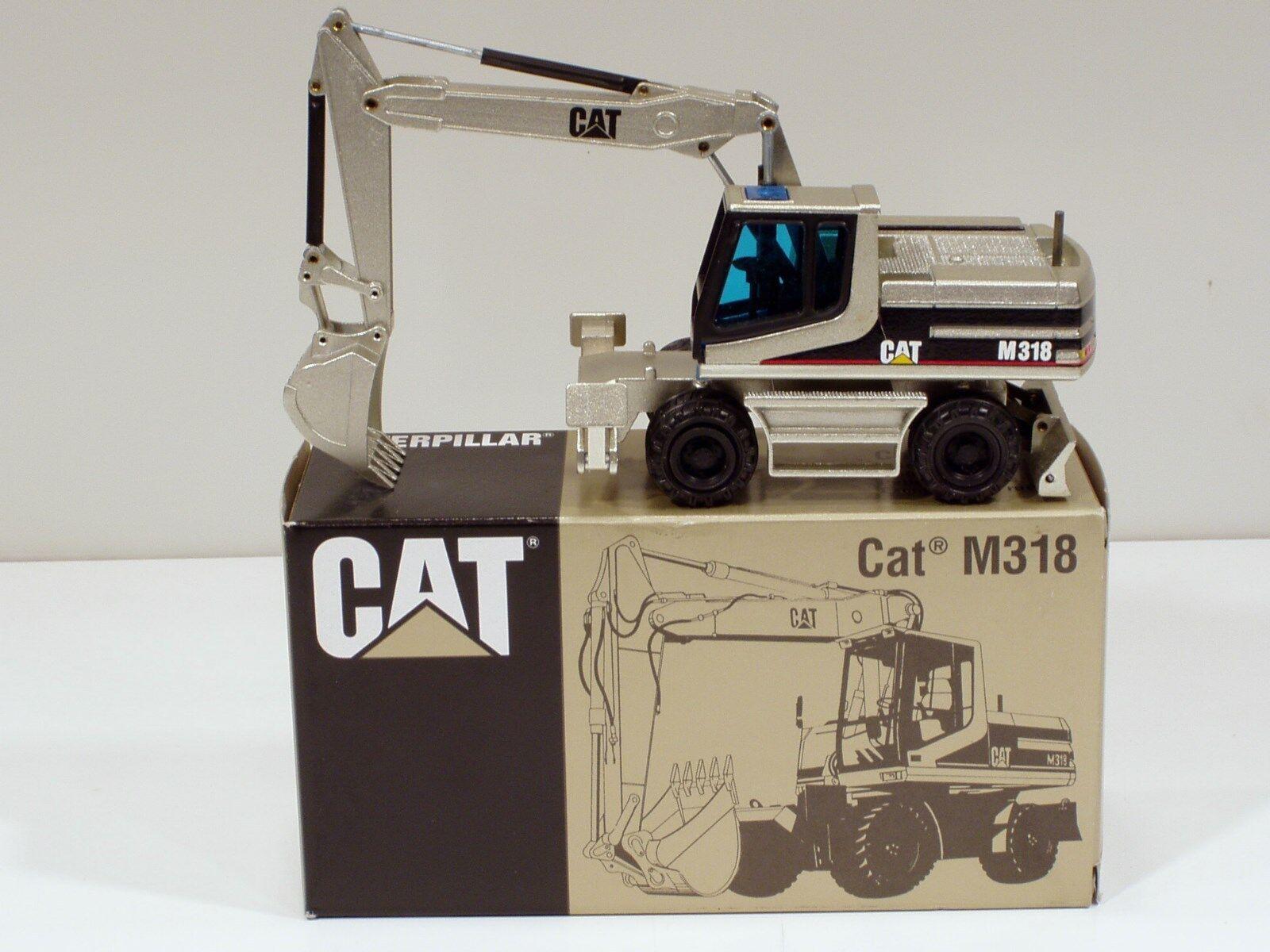 Caterpillar  M318 roue excavateur -  or pâle  - 1 50 - NZG  405.02 - Comme neuf IN BOX  autorisation officielle