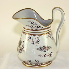 Antique white porcelain pitcher with hand painted crest and gold trim