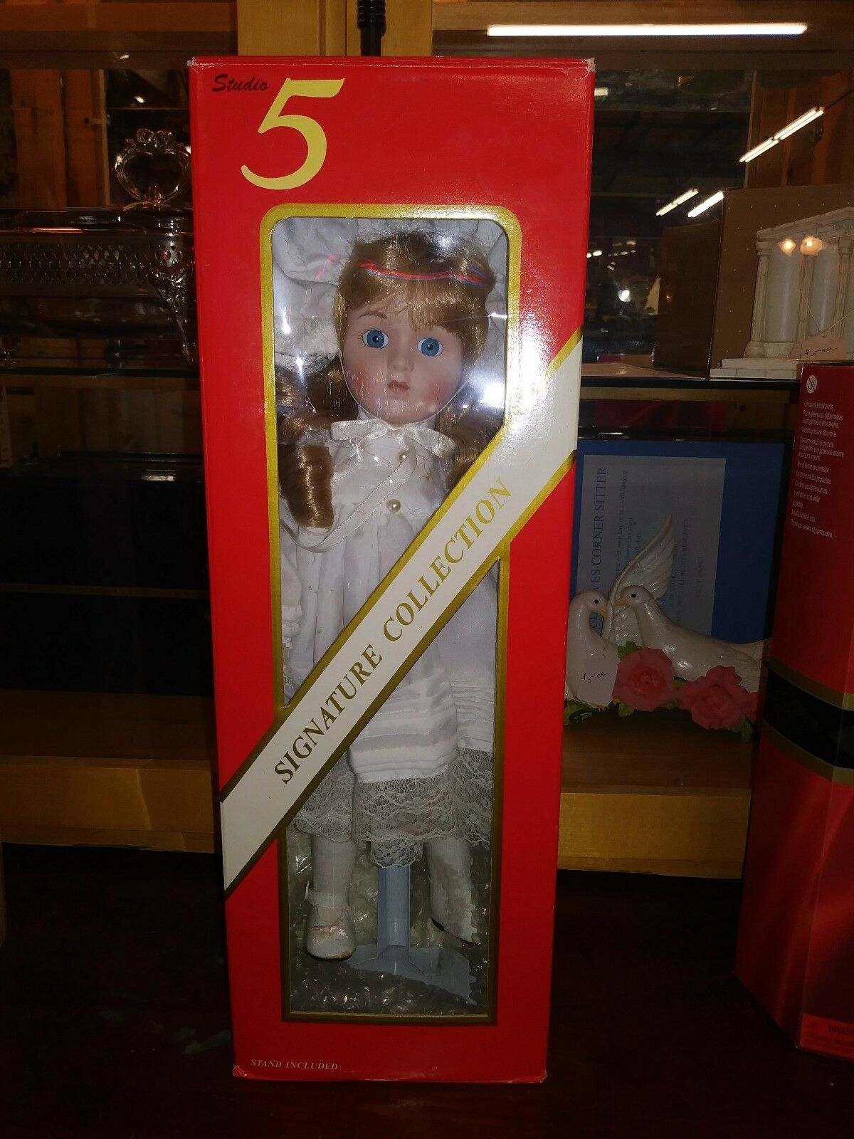 Heritage Signature 5 Collection. Porcelain doll new with stand in box