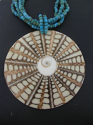 Shivas Eye Shell Operculum circular pendant multi-strand glass bead necklace