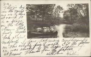 Man-in-Canoe-West-Medford-MA-in-Message-c1910-Real-Photo-Postcad