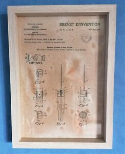 Cadre décoration vintage dépôt de brevet invention OPINEL