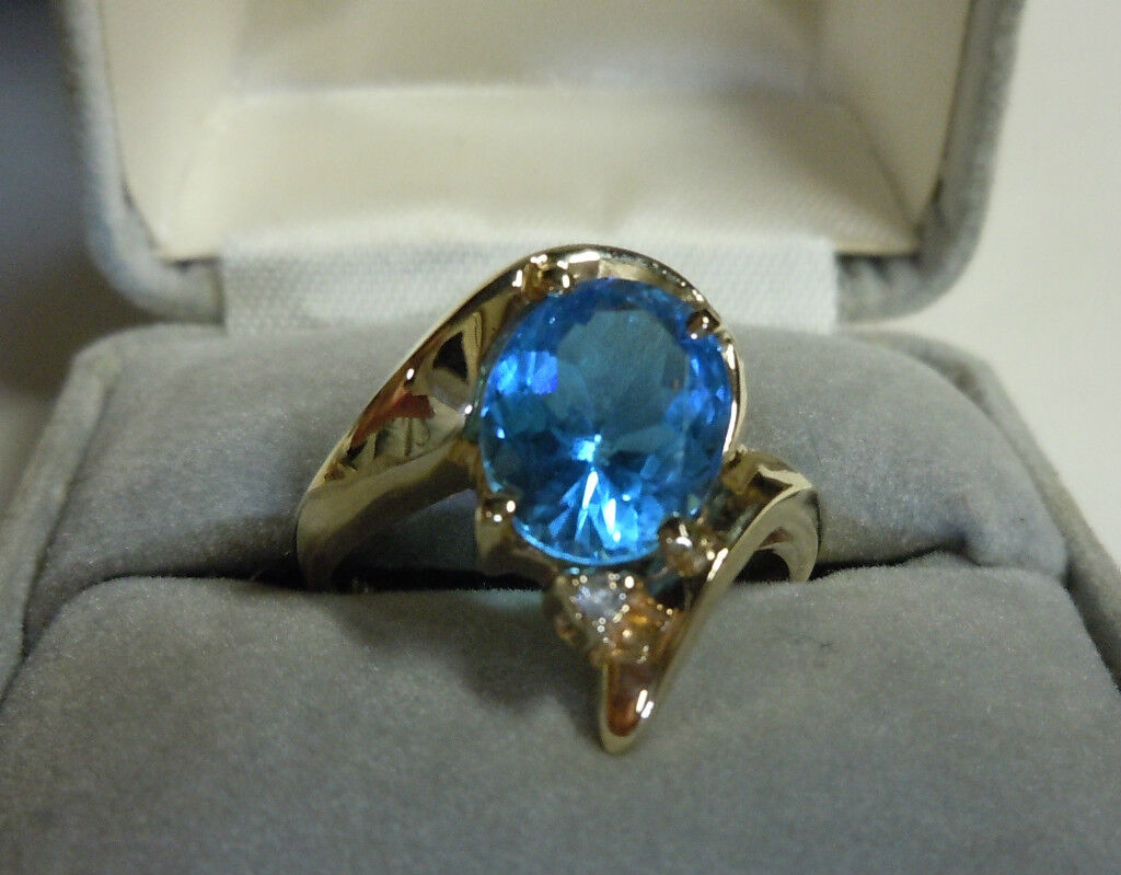 10KT gold blueE TOPAZ AND DIAMOND RING