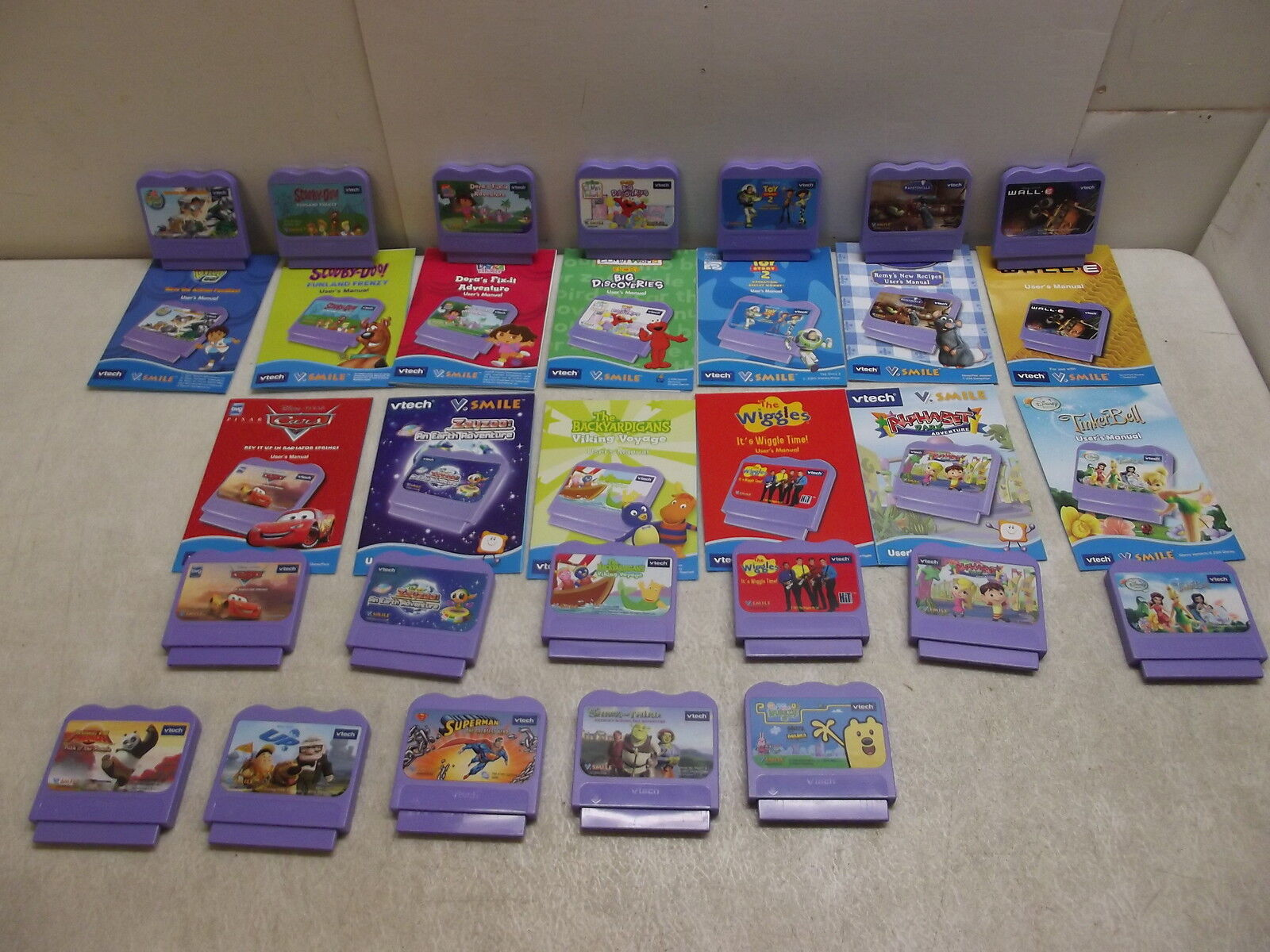 LOT OF 18 VTECH GAME CARTRIDGES WITH 13 MANUALS