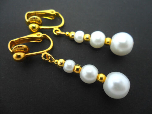 A PAIR OF DANGLY WHITE  GLASS PEARL  GOLD PLATED CLIP ON   EARRINGS.