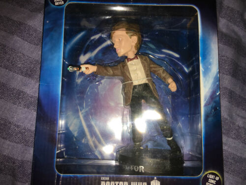 Doctor who 11th doctor figure   bobble head with light up sonic screwdriver.