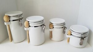 Details about Set of 4 white kitchen Canisters w/metal snap sealed  lids.Includes wooden spoons