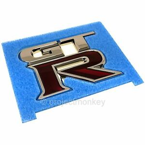 OEM-Nissan-84894-JF00A-09-17-GT-R-R35-Rear-034-GT-R-034-Emblem-Badge-GTR-Genuine-Part