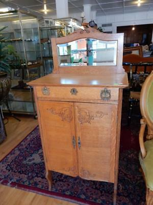 Lovely antique American oak carvedsheet music cabinet with mirrored ba... Lot 62