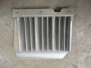 1969 Chevrolet Impala exterior front DRIVER Side grille filler panel trim piece