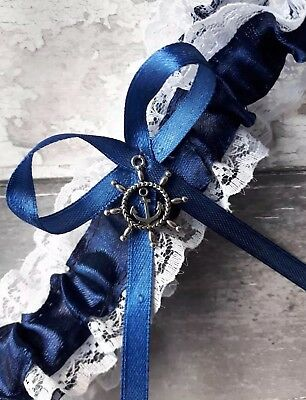 white lace navy satin ribbon wedding garter with anchor in a ships wheel charm