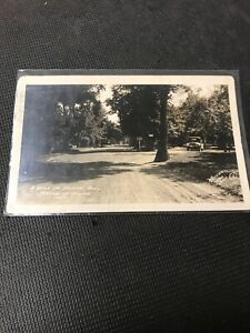 Postcard-A-Drive-In-The-Island-Park-Portage-La-Prairie-Manitoba-1923-Car-C01