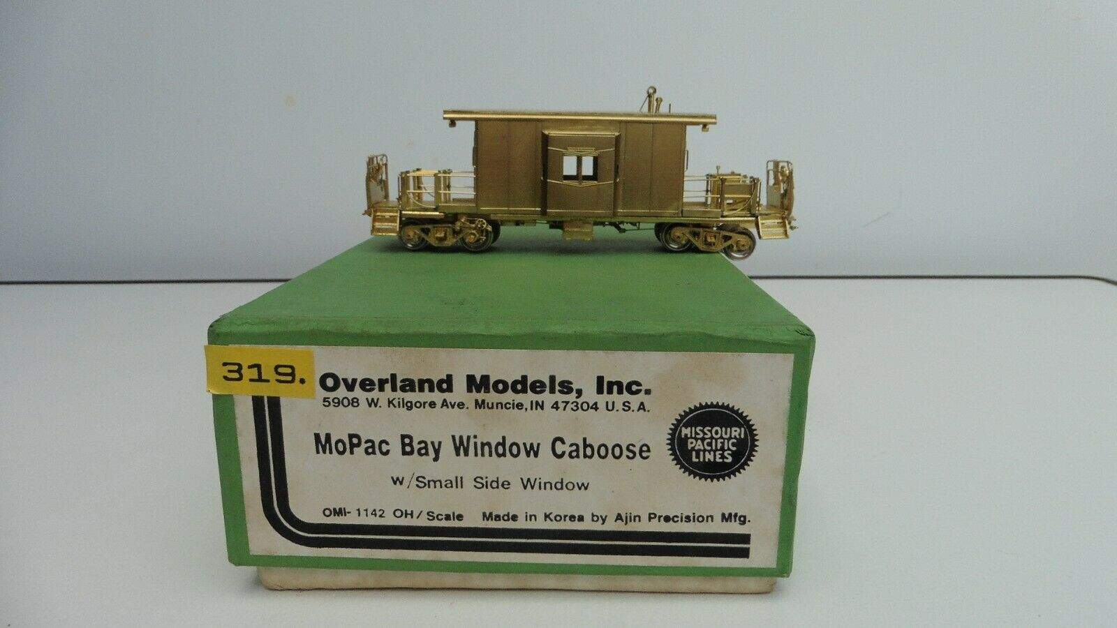 OMI Overland MoPac Bay Window Caboose with Small Side Window unlackiert Spur H0