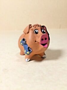 Clay pig. Girl with a bow. Mini.  Free. Q10