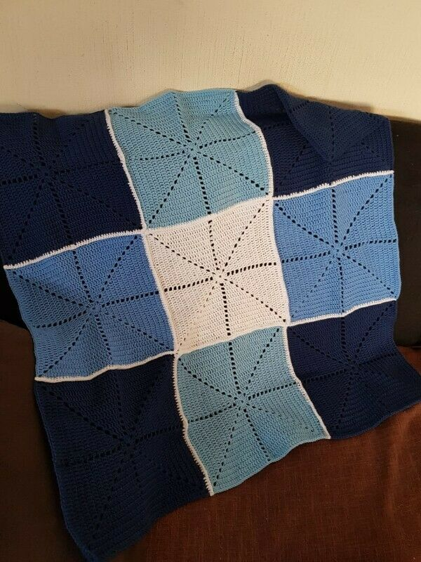 Hand crocheted and knitted baby wear, crib blankets, security blankets and more