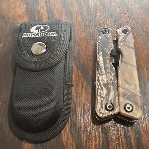 MOSSY OAK FOLDING MULTI TOOL KNIFE PLIERS FILE BOTTLE OPENER WITH SHEATH USED