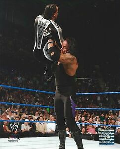 UNDERTAKER-VS-MVP-WWE-WRESTLING-8-X-10-LICENSED-PHOTO-NEW-525