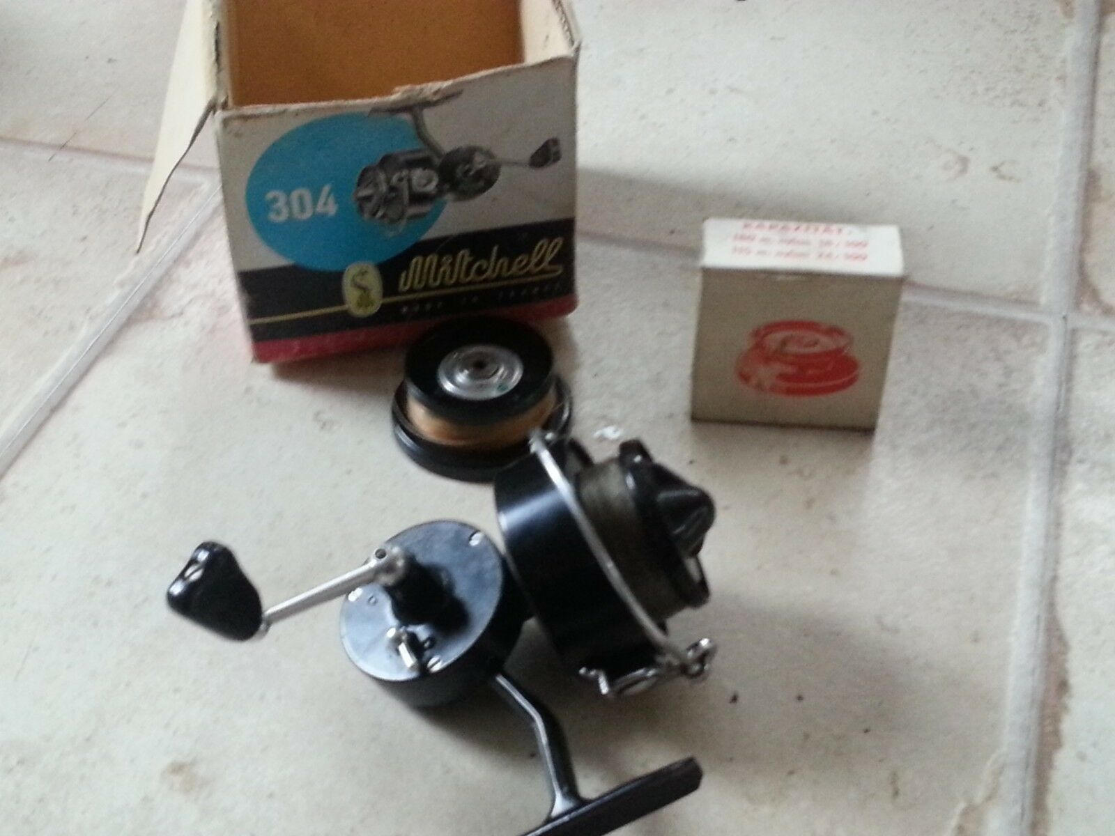 Vintage Mitclell 304 fishing reel and spear spool