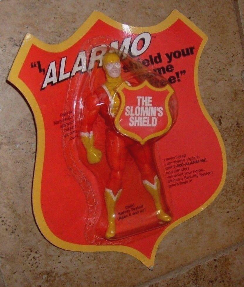 El escudo slomin's ALARMO rara 6  Exclusivo Promo Leyendas Figura directa con tarjeta