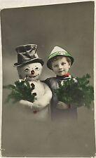 RPPC Real Photo Postcard ~ Boy & Snowman Hold Christmas Greenery ~ Hand Colored