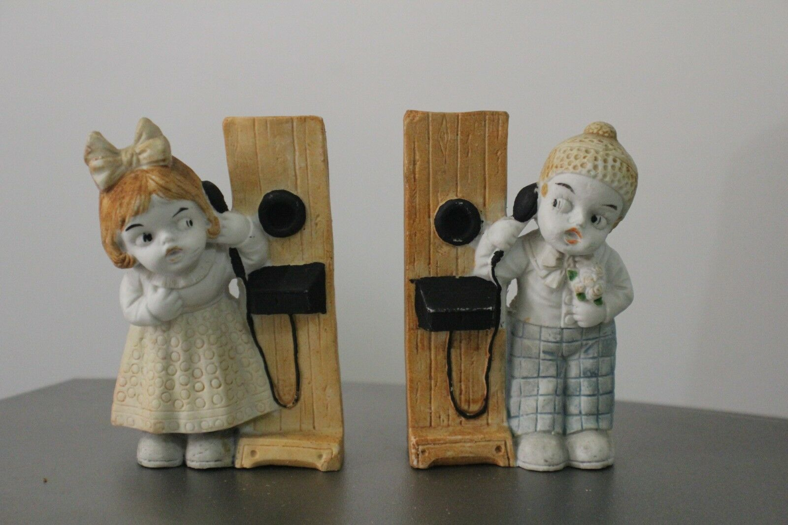 Uncommon Germany  Boy and Girl with Phone Bisque Figurines