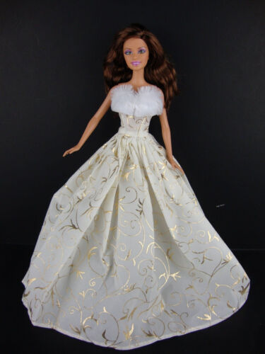 Ivory Gown with Gold Details and Fur Trim Part of the Limited Edition Christmas