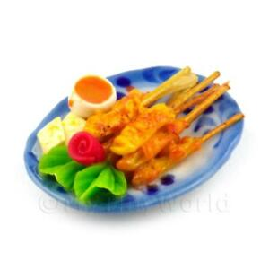Dolls-House-Miniature-Chicken-Satay-Skewers-On-A-Ceramic-Plate